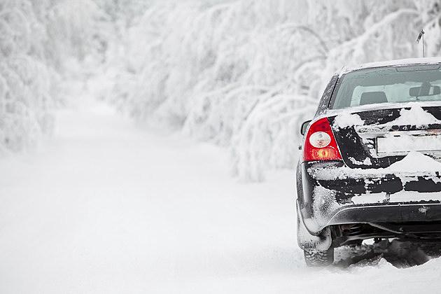 Black land vehicle standing on winter road