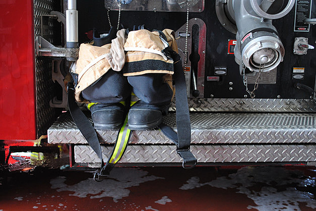 Firefighter Uniform and Boots on Firetruck, ready to go