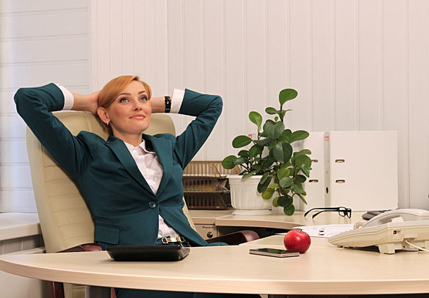 Beautiful Businesswoman in Her Office Dreaming